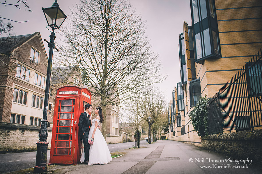 Bride and Groom by a telephone box